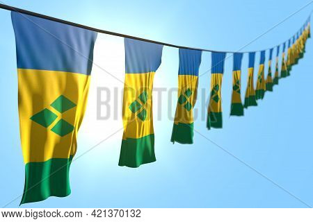 Beautiful Many Saint Vincent And The Grenadines Flags Or Banners Hanging Diagonal On String On Blue