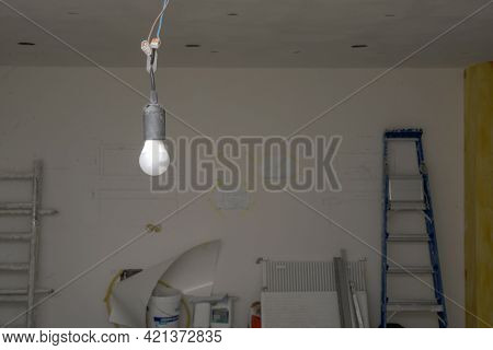 Temporary Light  At Construction Site,  Hanging From The Ceiling. Construction Site Background. Sele