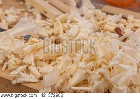 Wood Shavings On A Carpenter's Workbench. Carpentry Work On Wood.