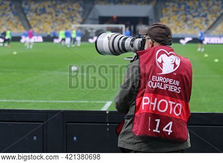 Kyiv, Ukraine - March 28, 2021: Photographer At Work Seen During The Fifa World Cup 2022 Qualifying