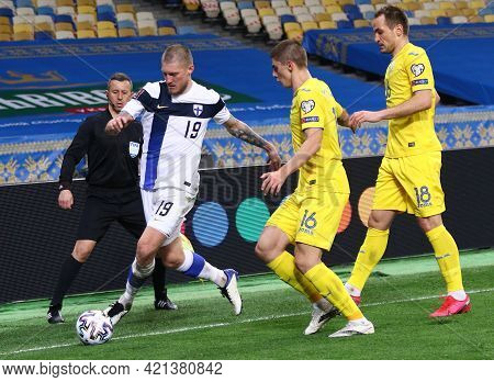 Kyiv, Ukraine - March 28, 2021: Joni Kauko Of Finland (l) Fights For A Ball With Vitaliy Mykolenko A