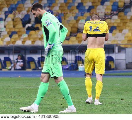 Kyiv, Ukraine - March 28, 2021: Goalkeeper Georgiy Bushchan Of Ukraine Reacts While Vitaliy Mykolenk
