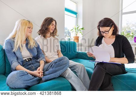 Teenagers Guy And Girl 16, 17 Years Old At Meeting With Teacher, School Psychologist, Counselor