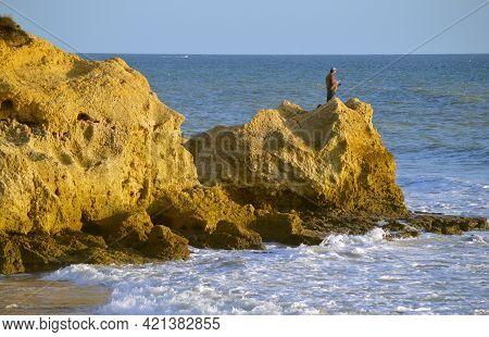 Ponta Da Piedade, Algarve, Portugal - October 28, 2015 : Man Fishing Form The Rock Formations On Sie