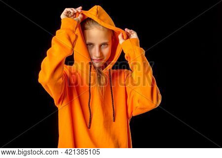 Shot Of Beautiful Stylish Teenage Girl. Portrait Of Attractive Teenager Wearing Warm Orange Hoodie P