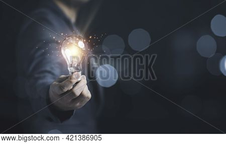 Businessman Holding Glowing Lightbulb With Light Ray For Creative Thinking Ideas And Innovation Conc