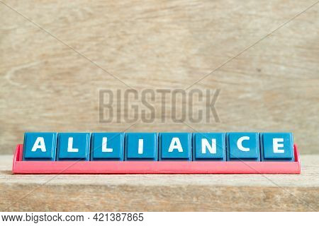 Tile Alphabet Letter With Word Alliance In Red Color Rack On Wood Background