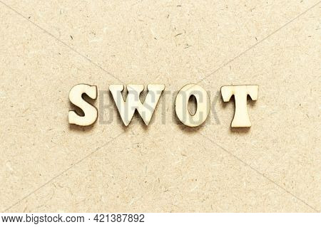 Alphabet Letter In Word Swot (abbreviation Of Strength, Weakness, Opportunities, Threats) On Wood Ba