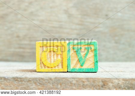 Color Alphabet Letter Block In Word Cv (abbreviation Of Curriculum Vitae) On Wood Background