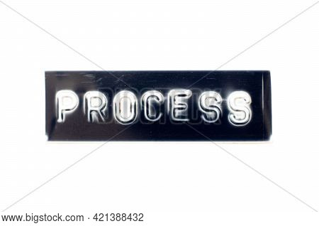 Embossed Letter In Word Process On Black Banner With White Background