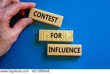 Contest For Influence Symbol. Wooden Blocks With Words 'contest For Influence'. Beautiful Blue Backg