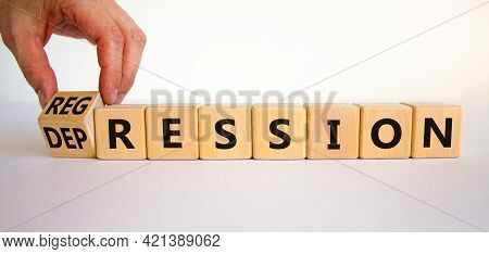Depression Or Regression Symbol. Doctor Turns Cubes And Changes The Word 'depression' To 'regression