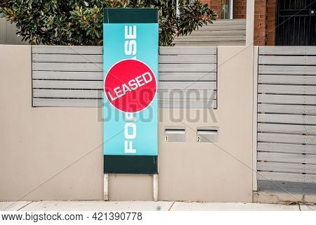 For Lease And Leased Sign On A Display Outside Of A Residential Building
