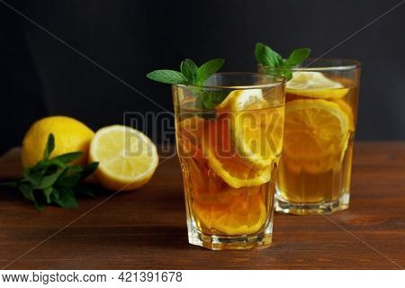 Traditional Iced Tea With Lemon And Ice In Tall Glasses.
