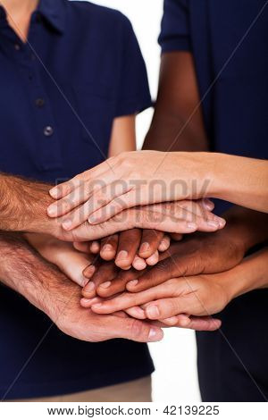 team hands together to form unity