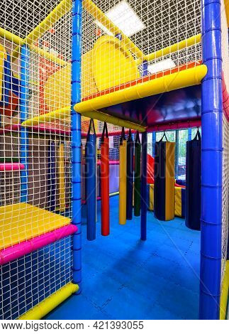 Kids Playground Indoors, Inside Nice Multi-level Playroom For Sport Playing. Vertical View Of Colorf