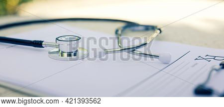 Close-up Of Rx Prescription And Stethoscope For Background