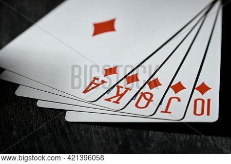 Royal Flush On A Black Background. Playing Card. The Concept Of Victory.