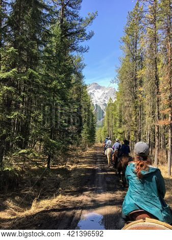 Kananaskis, Alberta, Canada - May 15th, 2021: A Group Of People Riding Horses During A Guided Tour I