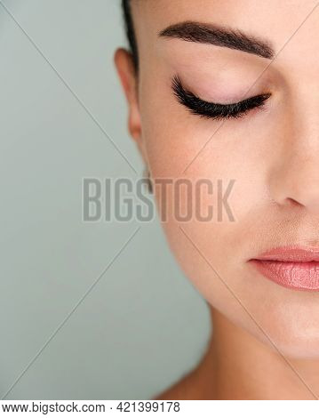 Beautiful Girl With Extended Eyelashes And Eyes Closed