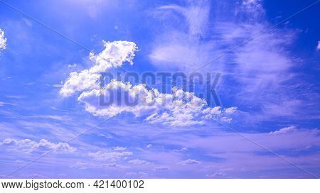 Heavenly Bright Clear Blue Sky With Puffy Angelic Spiritual Clouds