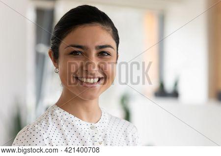 Head Shot Portrait Of Confident Successful Smiling Indian Businesswoman