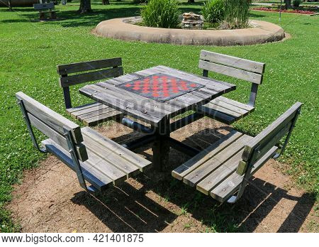 Four Seat Wooded Chess And Checkers Game Board Table Set In A Public Park