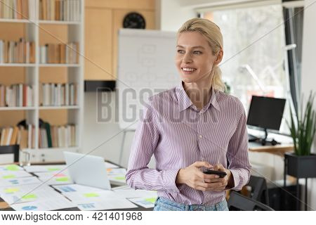 Close Up Dreamy Smiling Businesswoman Holding Smartphone, Looking To Aside