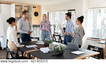 Diverse Employees Team Involved In Briefing, Standing In Office Room