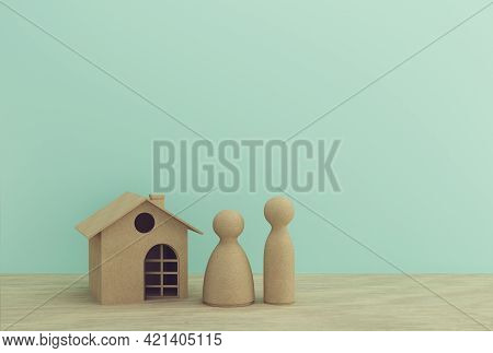 Creative Idea Of House Model Paper And Family On Wooden Table. Property Investment Real Estate And H