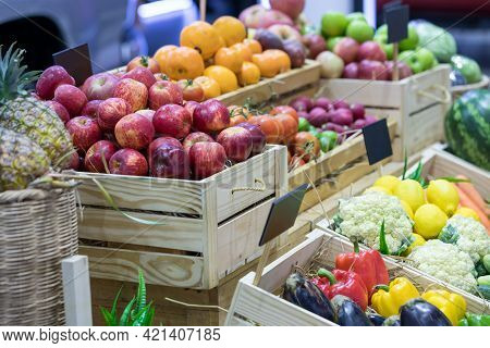 Fresh Fruits At A Market. Fruit Stall In The City Market. Fruits In Baskets On Market Place.
