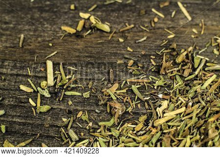 Dried Thyme Spilled On Gray Wooden Board