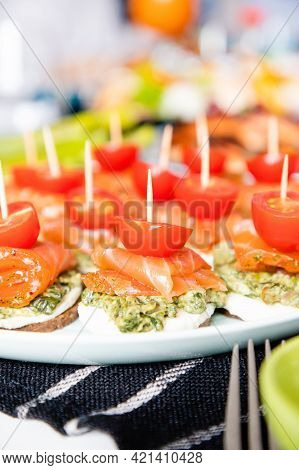 Homemade Canapes With Red Fish, Pesto And Cherry Tomatoes, Tapas