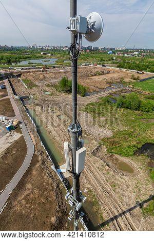 Telecommunication Tower With Microwave Equipment 5g, Radio Panel Antennas, Outdoor Remote Radio Unit