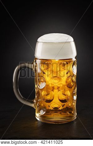Stein With Fresh Beer With Cap Of Foam On A Black Background.