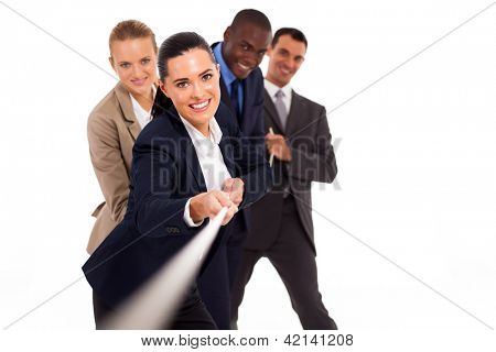 group of business people playing tug-of-war