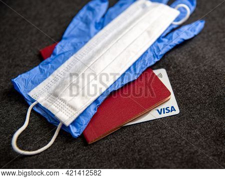 Mari El, Russia - May 10, 2021: Credit Silver Visa Card In The Document With Blue Glove And White Ma