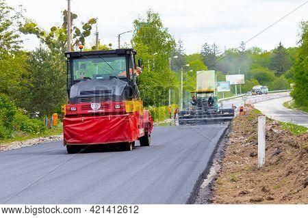 Ukraine, Khmelnytsky Region, Krasyliv. May 2021. Asphalt Paver And Roller On The Road During Asphalt