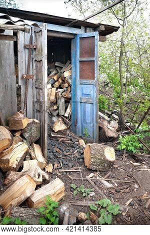 Wood Shed With Firewood. A Pile Of Firewood. Lots Of Wood Logs Are Stacked In The Wood Shed. Rustic