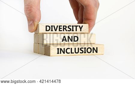 Diversity And Inclusion Symbol. Wooden Blocks With Words 'diversity And Inclusion' On Beautiful Whit
