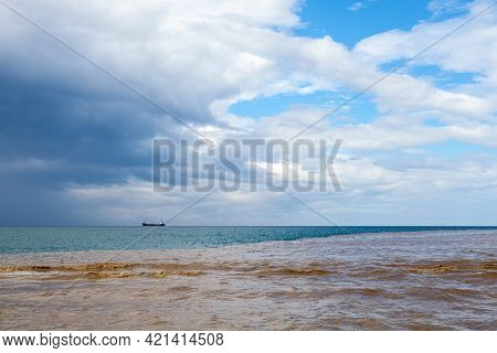 Summer Coastal Seascape With Muddy River Water Mixed With Blue Seawater. Crimea, Black Sea, Russia