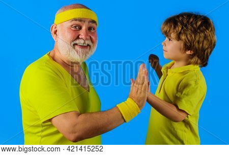 Healthy And Active Lifestyle. Family Time Together. Sporting. Grandpa And Cute Grandson In Sportswea