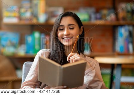 Happy Laitin Woman Thinking About Future Plans, Writing List To Do In Notepad While Sitting In Cafet