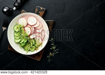 Fresh Salad With Red Radish, Cucumber, Vegetables, Microgreen Radishes In White Plate On Grey Stone