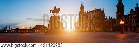 Night panorama of Dresden Theater Palace and sculpture of King Johann