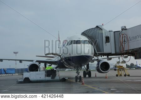 Moscow, Domodedovo 2.09.2020 - High Loader Loads Luggage And On-board Meals Onto Plane. Preparing Ai