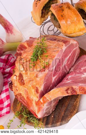 Smoked Meat In A Large Piece On A Wooden Board