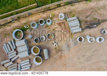 Stacked Concrete Pipes To Construct Drainage Systems On Building Materials Stack Of Boards Metal Fra