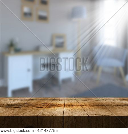 3D render of an old wooden table looking out to a defocussed lounge interior with sun rays