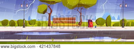 Storm With Rain And Lightning In City Park With Green Trees And Grass, Wooden Bench, Puddles And Tow